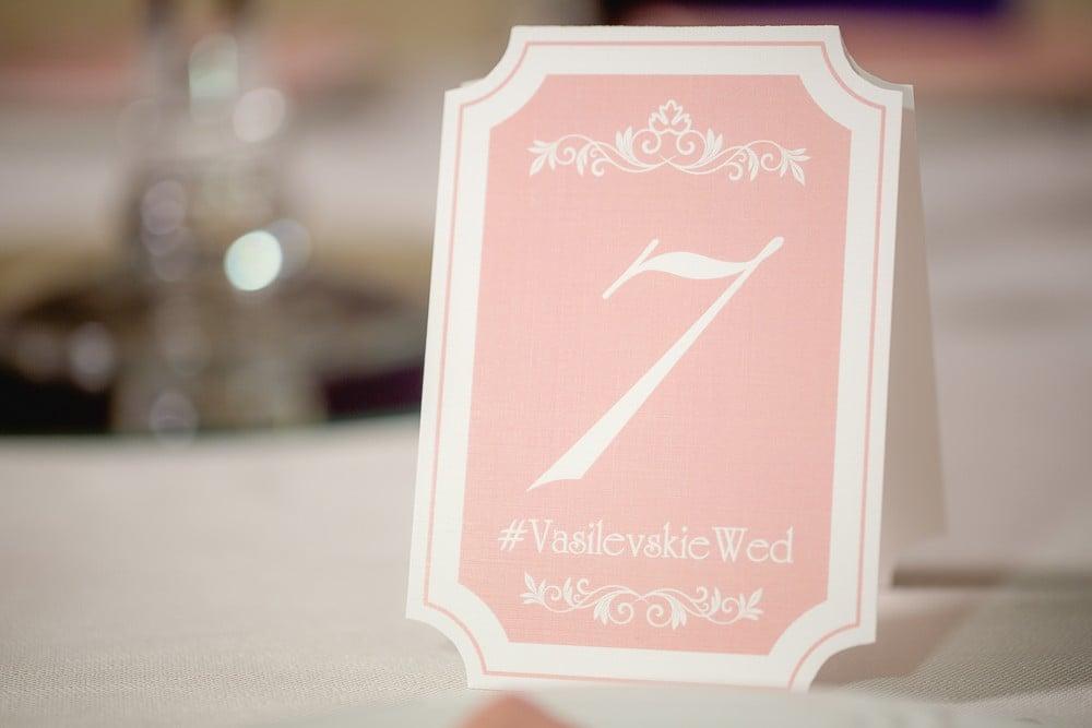 wedding hashtag on table