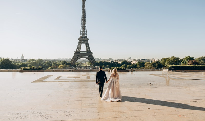 married couple at the Eiffel Tower