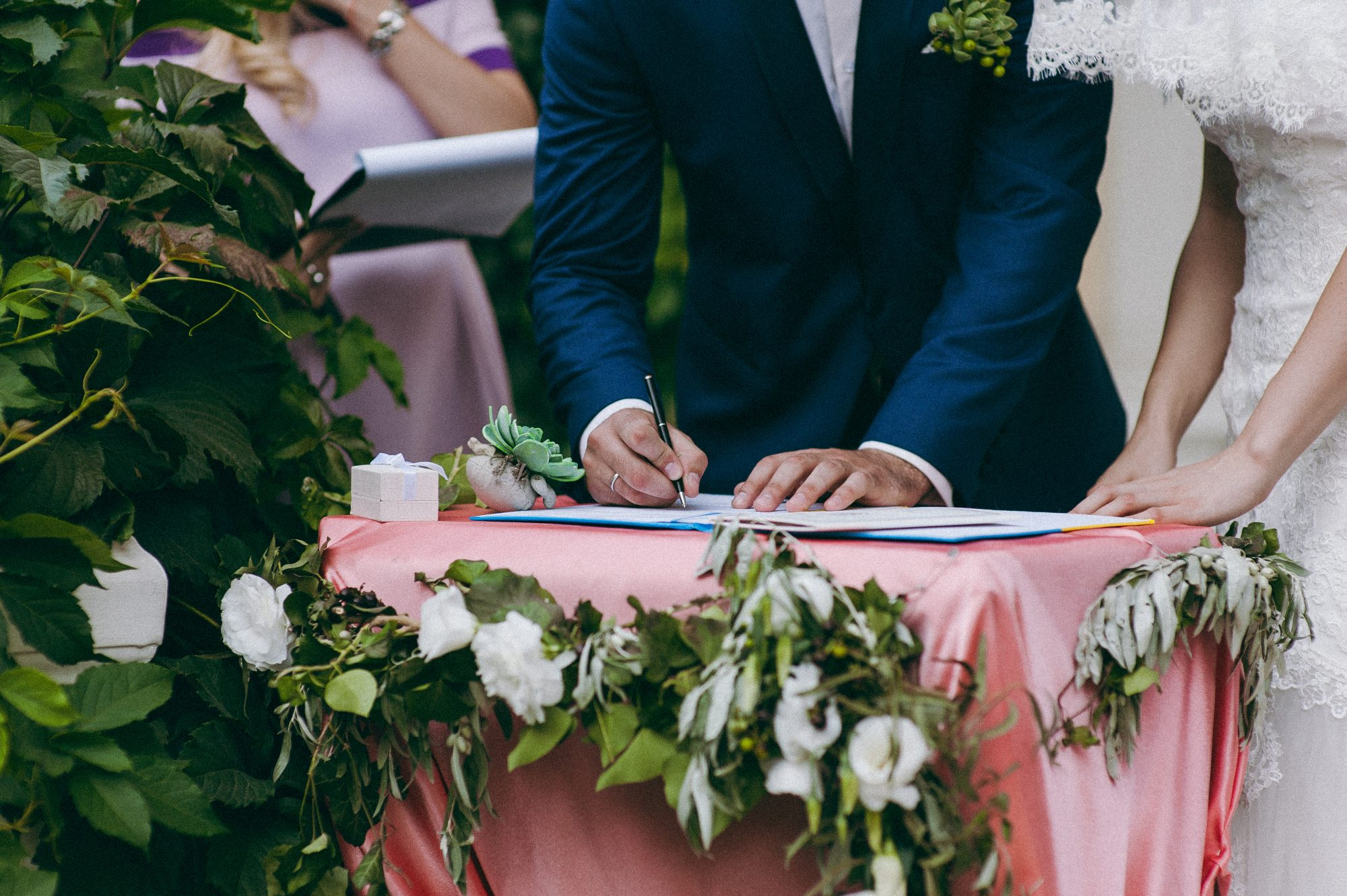 best man witnessing marriage license signatures