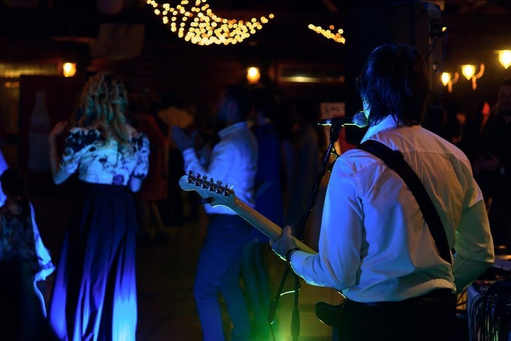 dancing to band at wedding