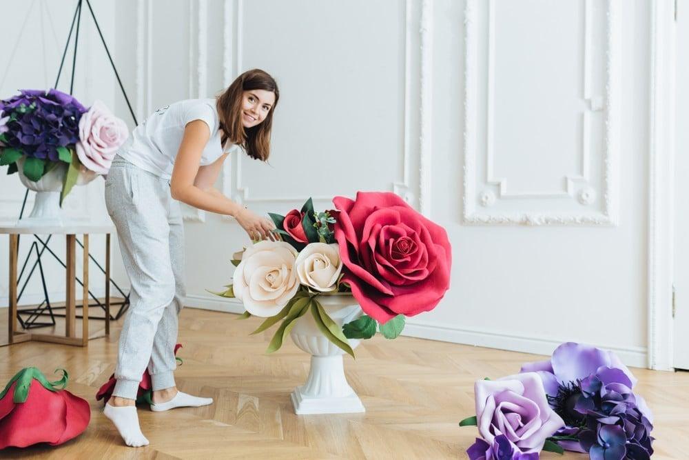wedding decorator setting up flowers