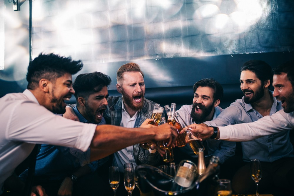 men cheers at bar