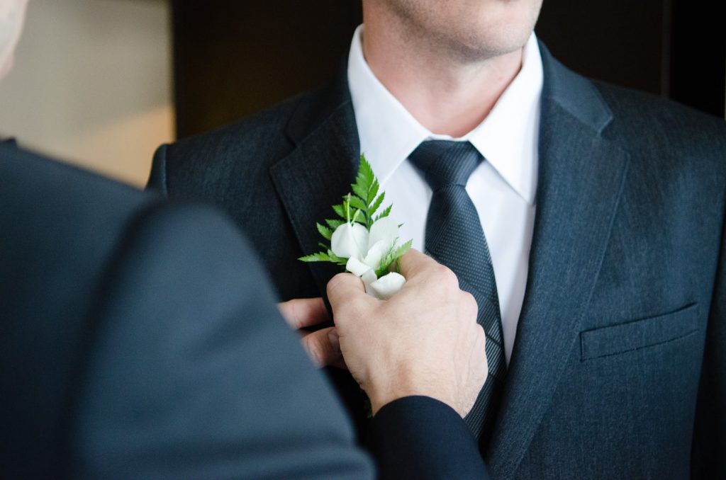 getting ready to throw the boutonniere as garter toss alternatives