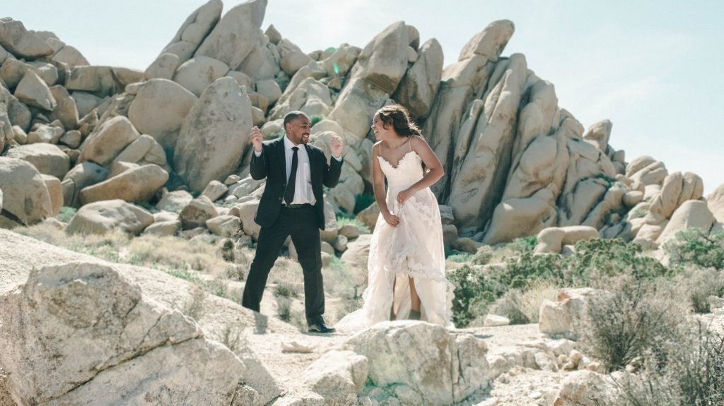a couple wearing desert wedding attire