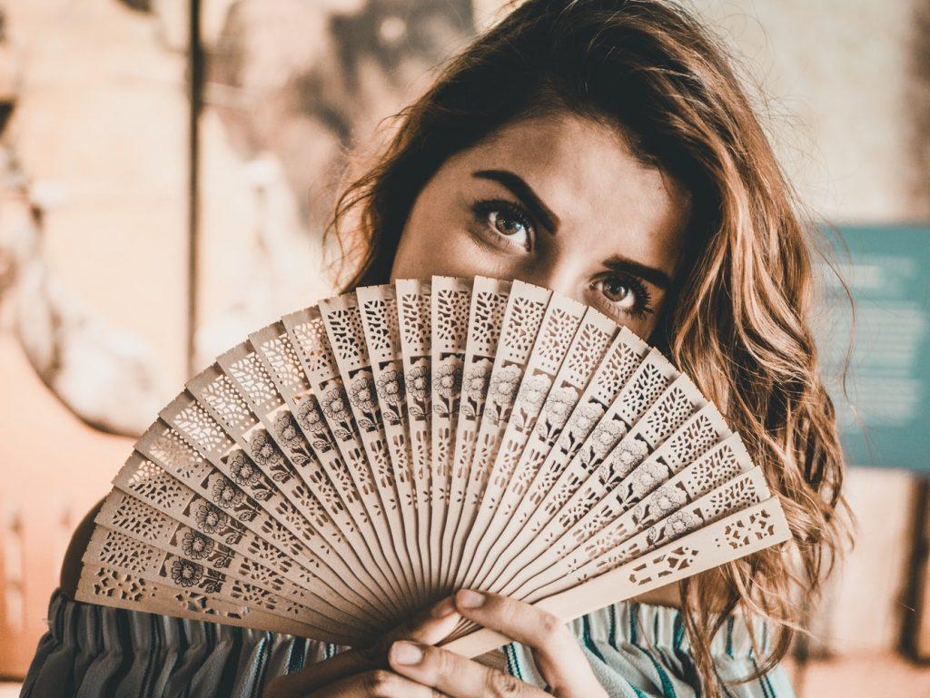 lady holding a hand fan