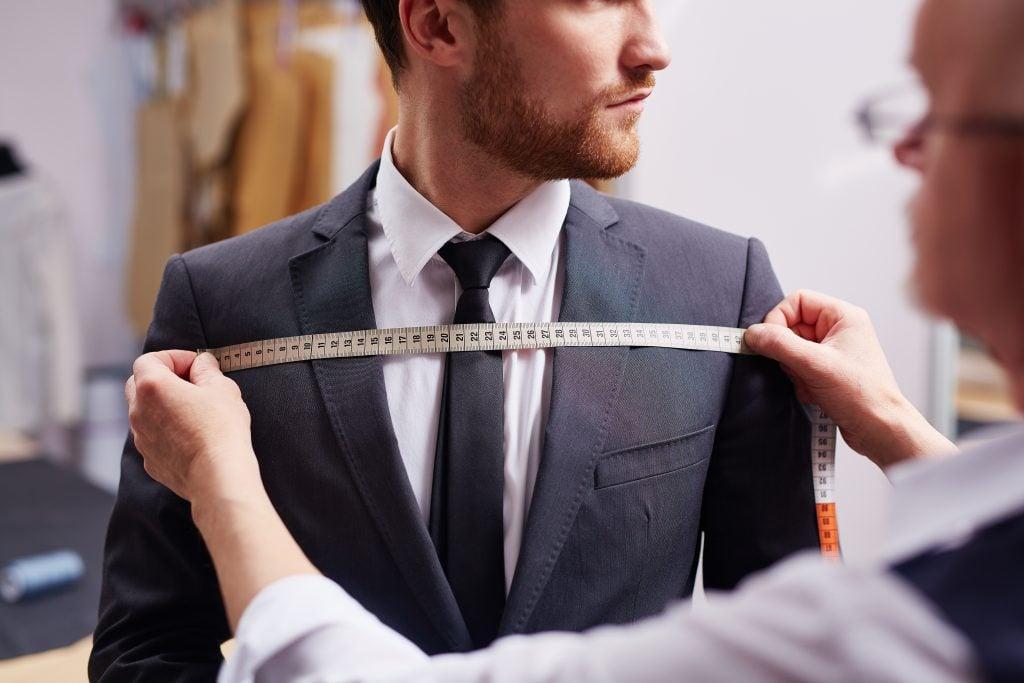 man measuring suit
