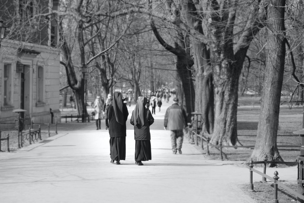 nuns walking down street