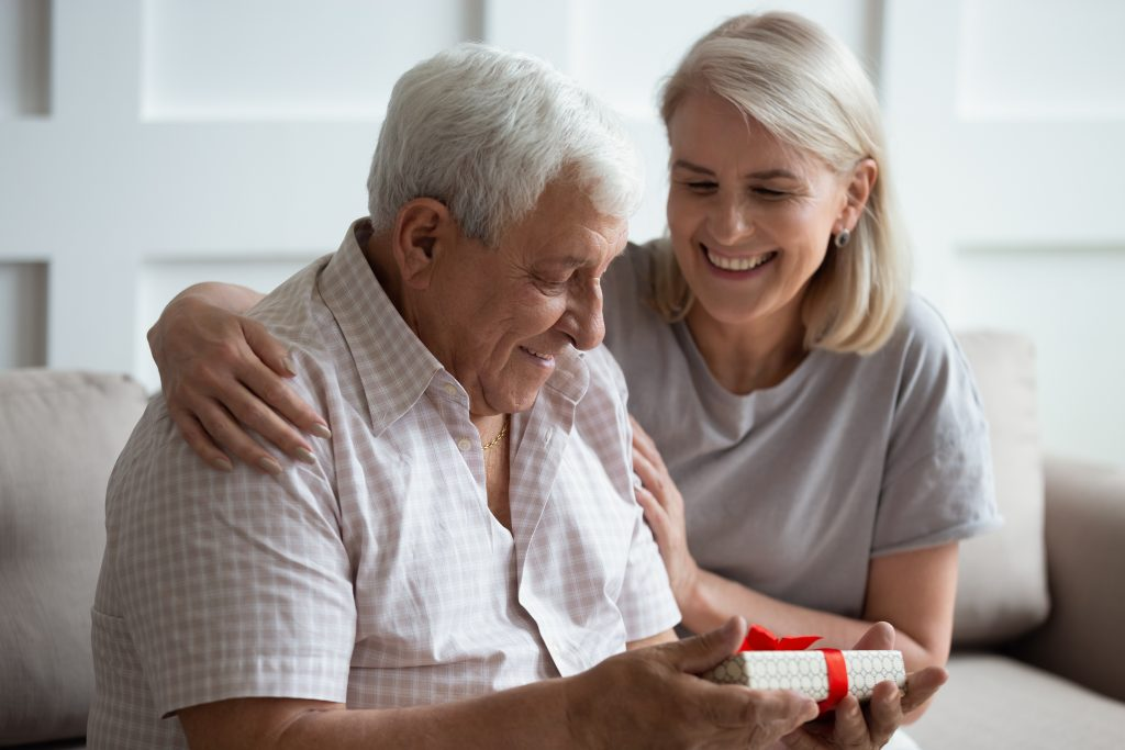 older couple giving gifts