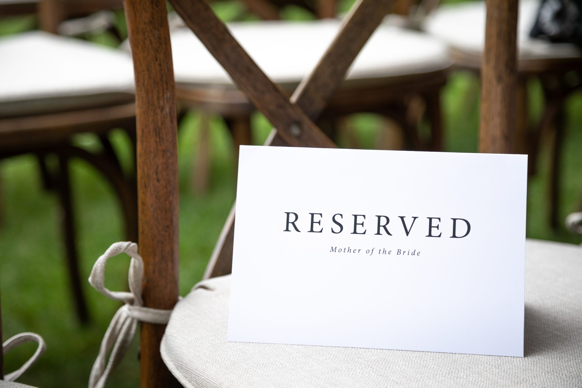 reserved seat card at wedding