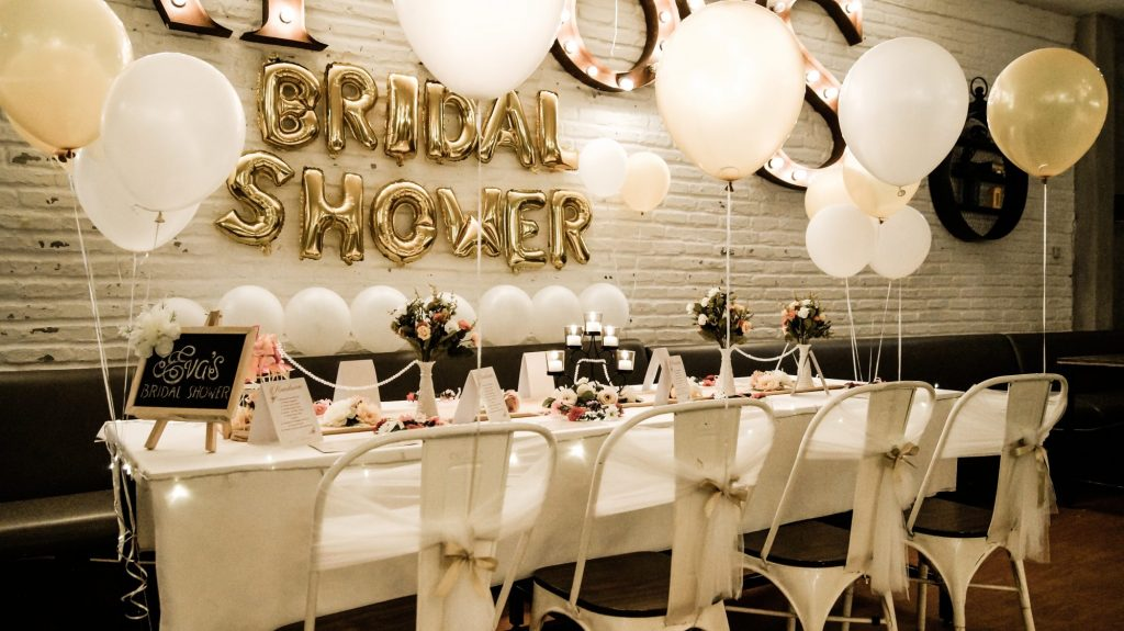 table with balloons and bridal shower banner