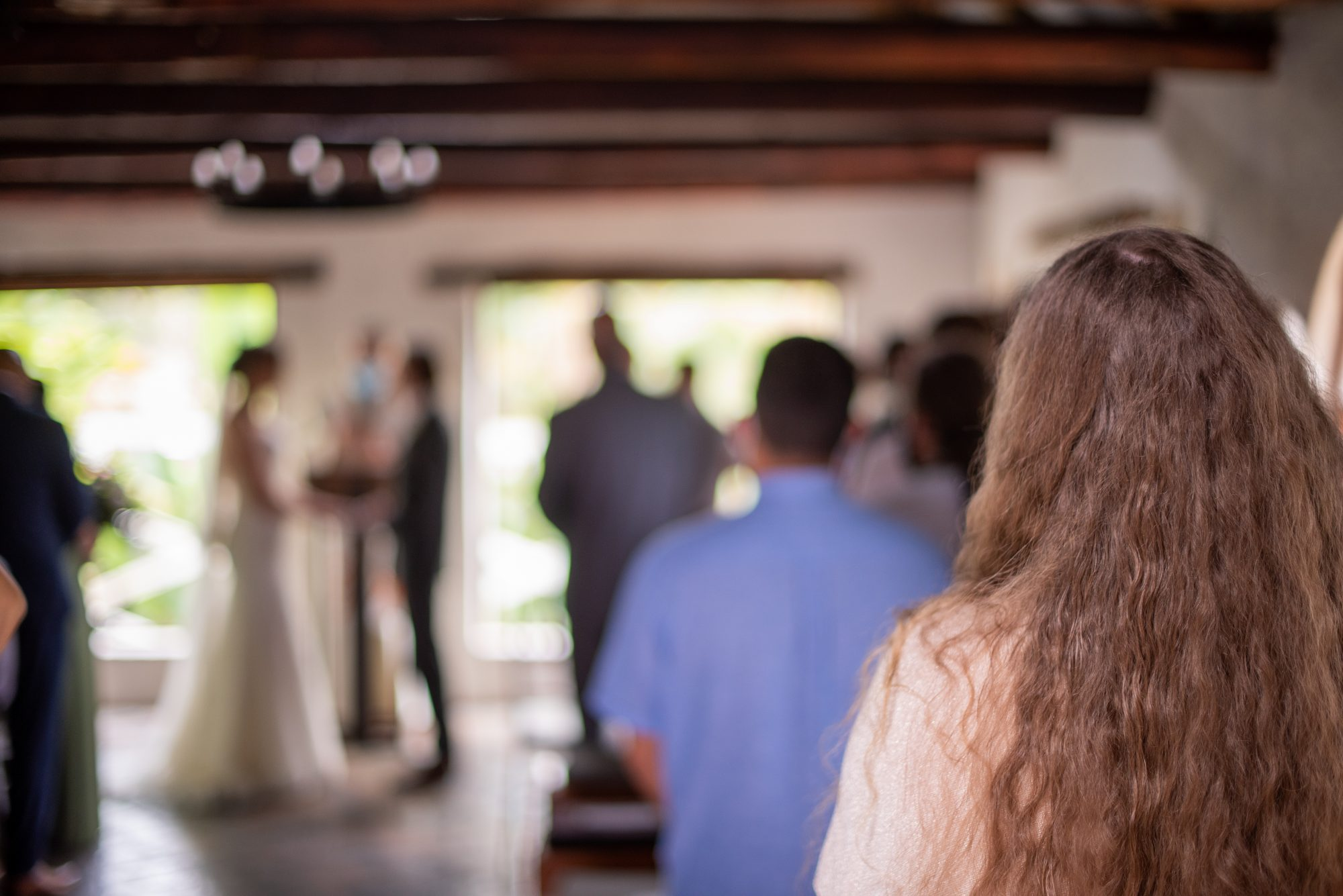 view of wedding guests and couple