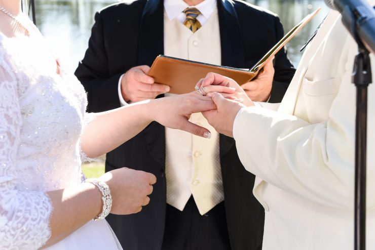 bride, groom, and wedding officiant