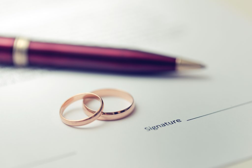wedding rings and marriage certificate