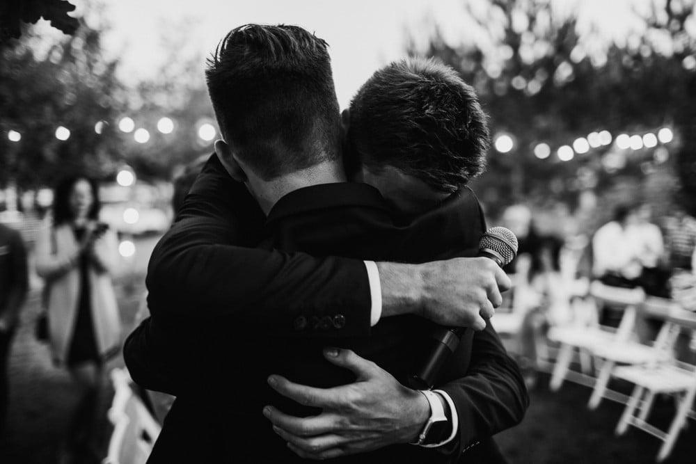 best man hugging groom