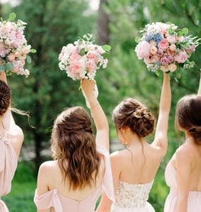 bridesmaids hairstyles with bouquets