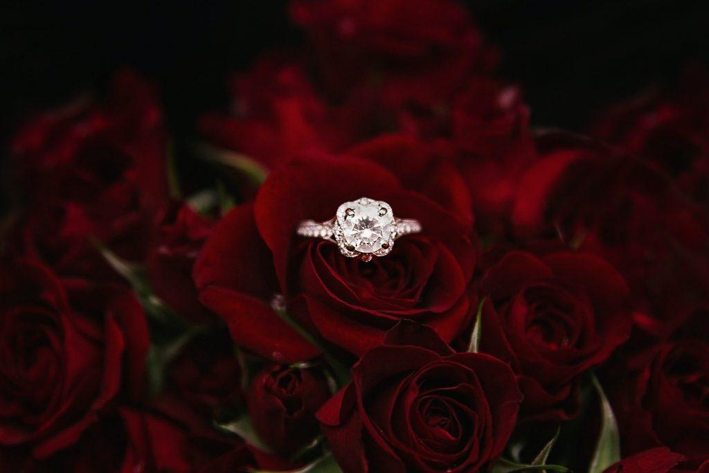 wedding ring on rose