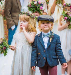 young boy and girl at wedding