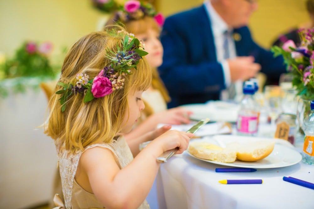 little girl eating at wedding