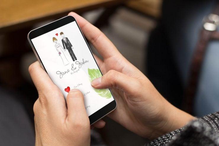 digital wedding invitation on phone