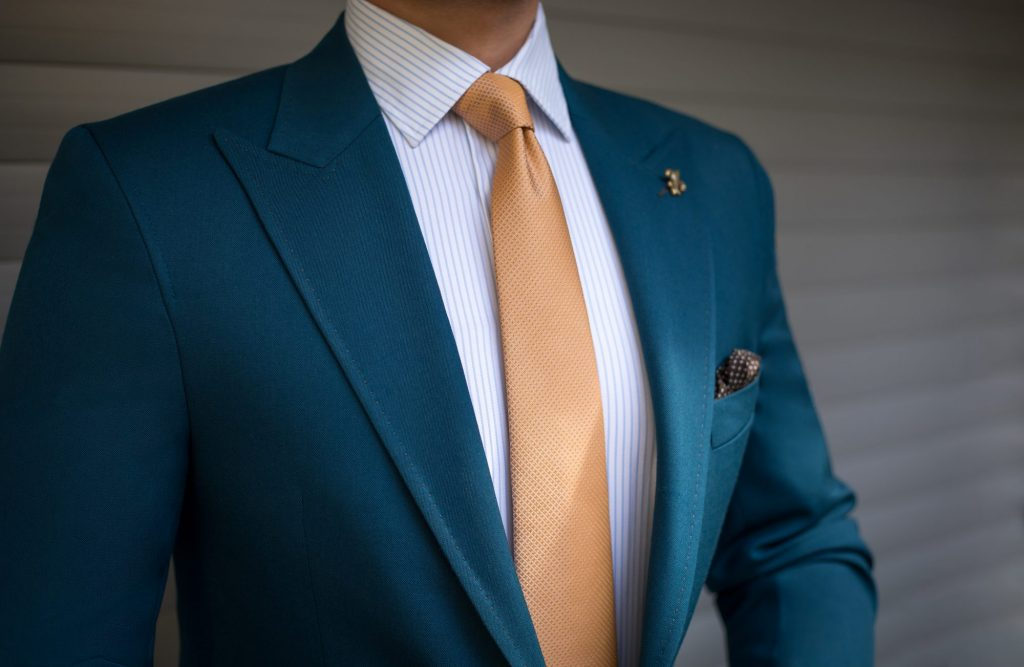 blue and gold suit and tie