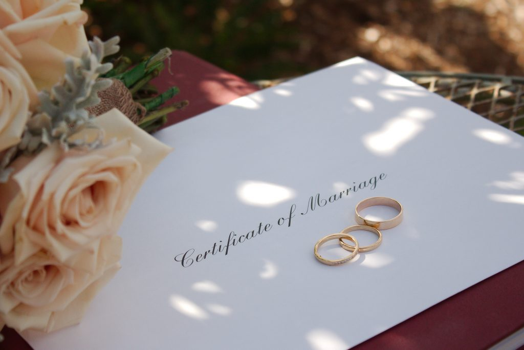 marriage certificate and rings