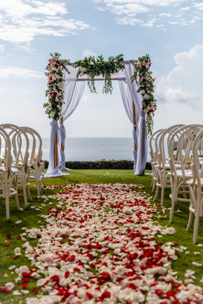 rose petals on wedding aisle