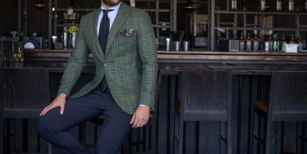 man in green plaid suit