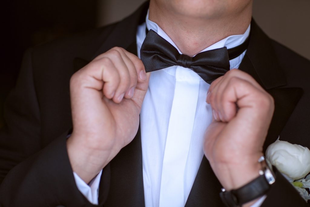 man in suit and bow tie