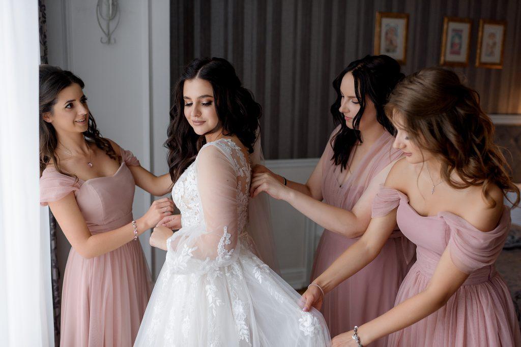 wedding party helping bride get ready