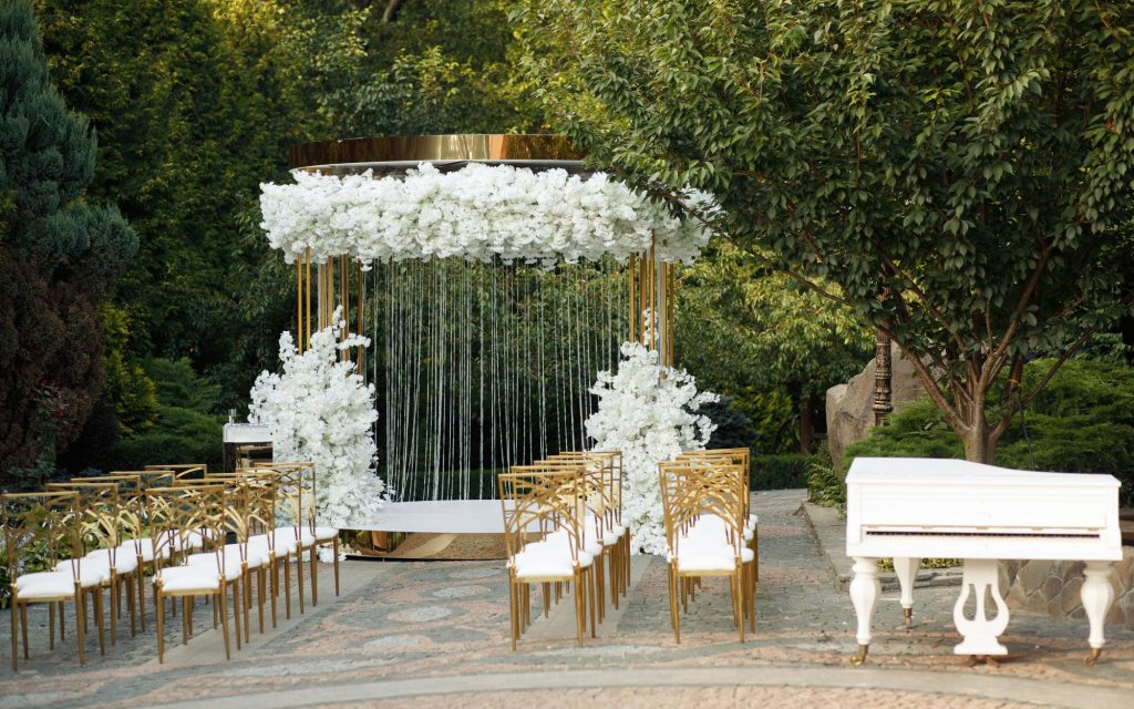 green and gold outdoor wedding decor
