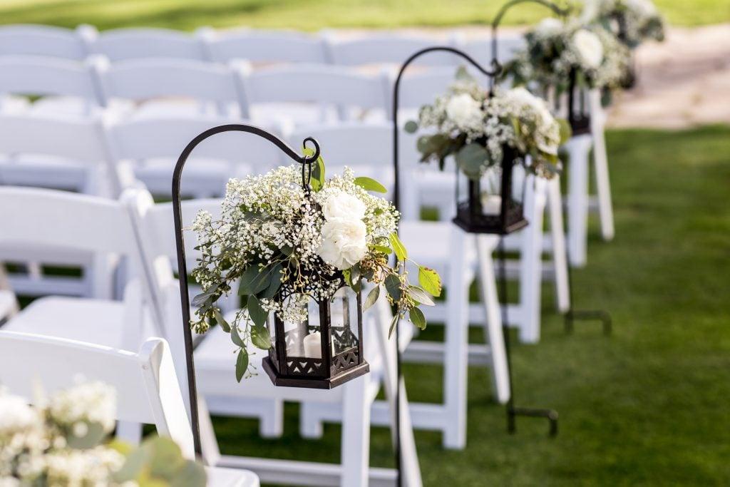 lanterns and flowers lining wedding aisle