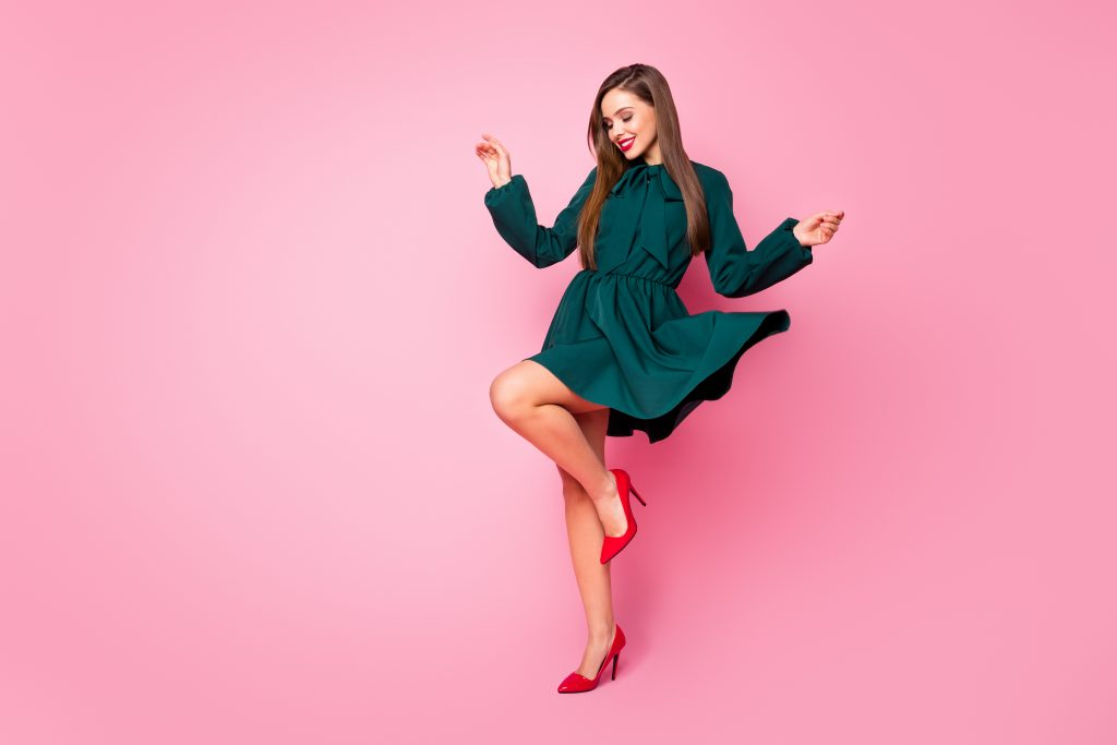 woman in short green dress