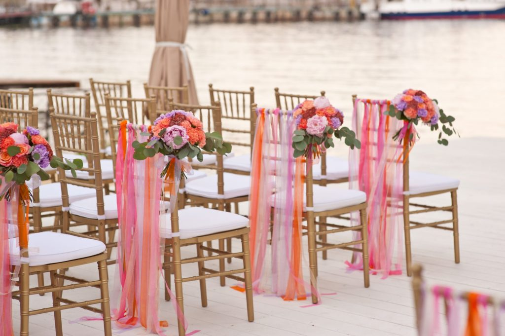 bouquets and tulle on wedding chairs