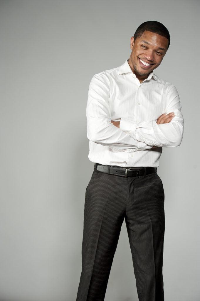 man in dress shirt and slacks