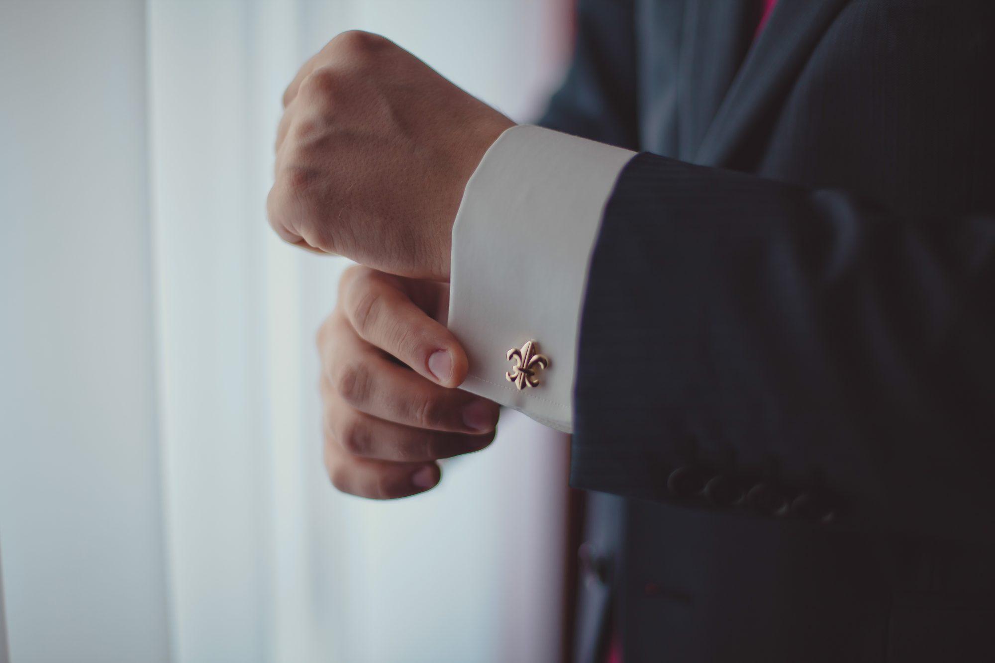 man in gold cufflinks