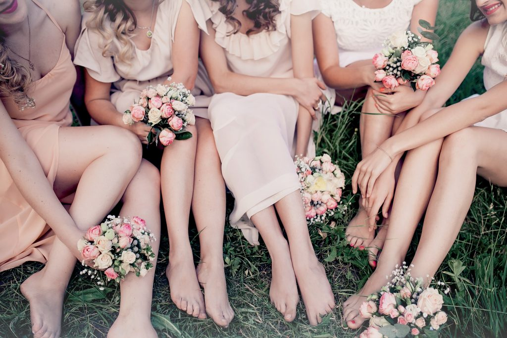 bride and bridesmaids flowers and feet