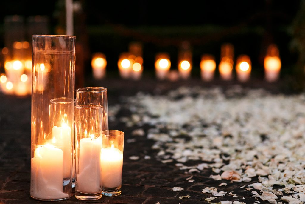 wedding aisle lined with candles and flowers