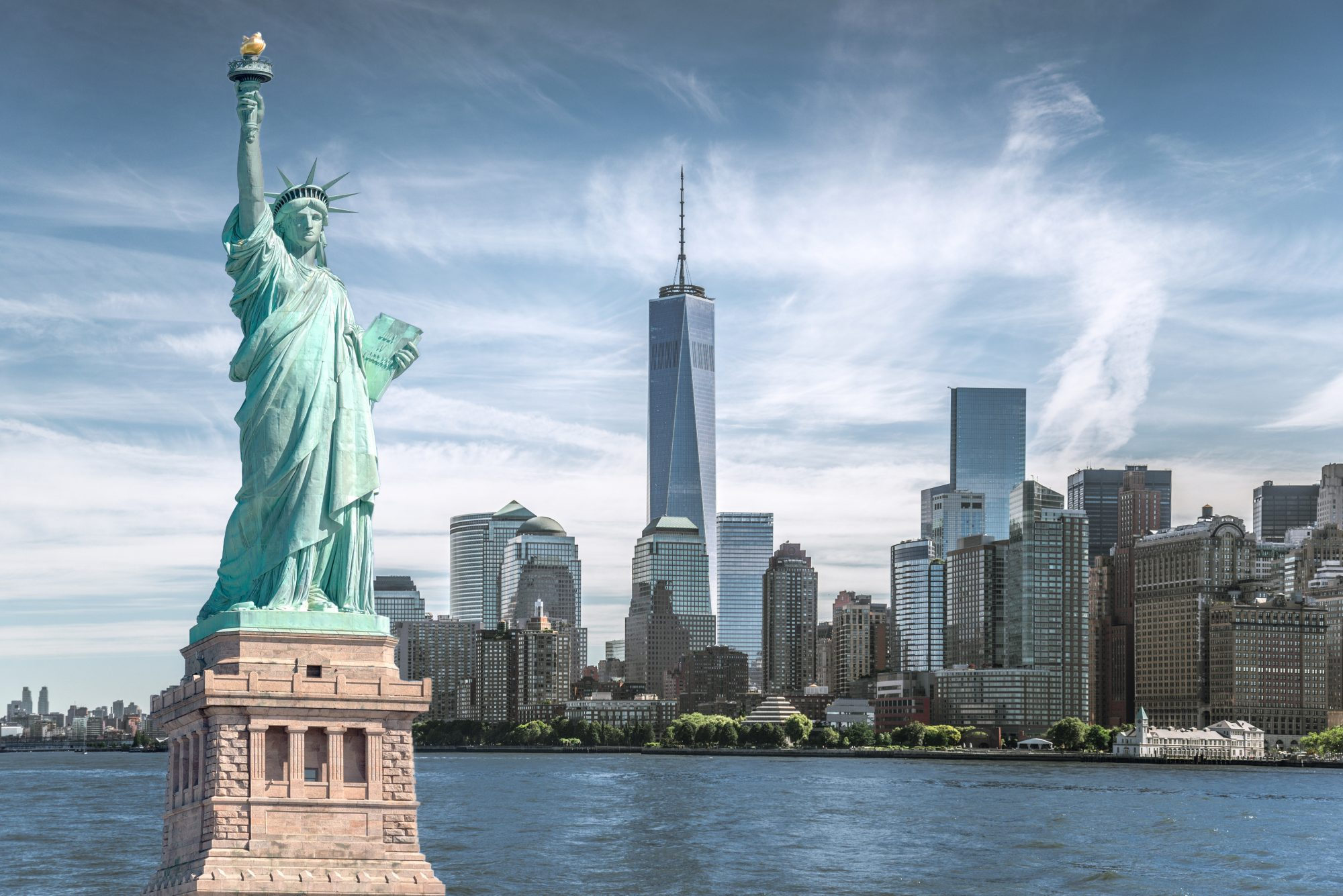 statue of liberty and 1 world trade in nyc