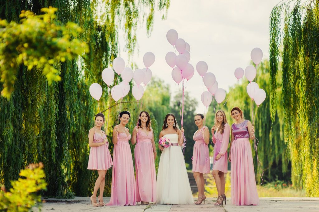 bride and bridesmaids holding balloons