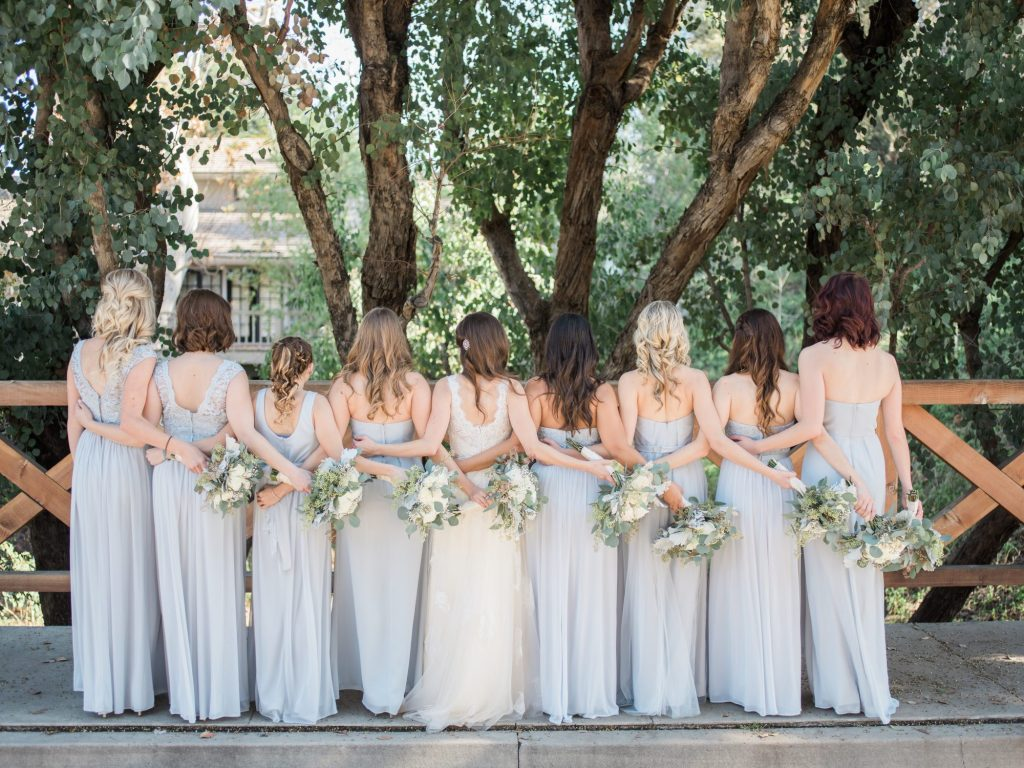 bride and bridesmaids with backs to camera
