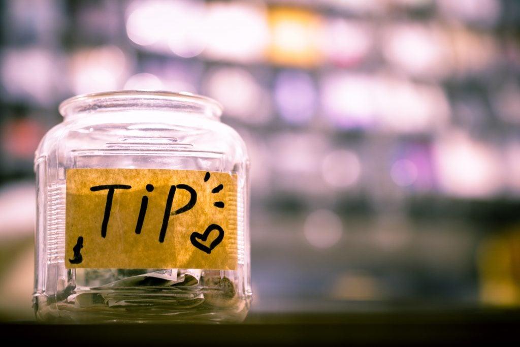 tip jar with cash