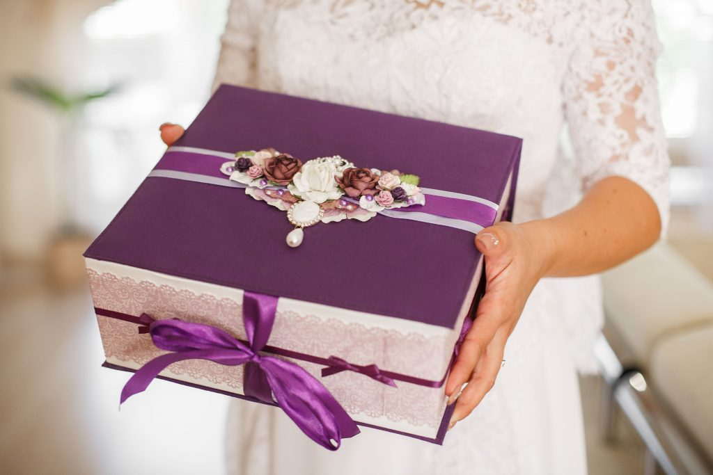 bride holding a wedding box
