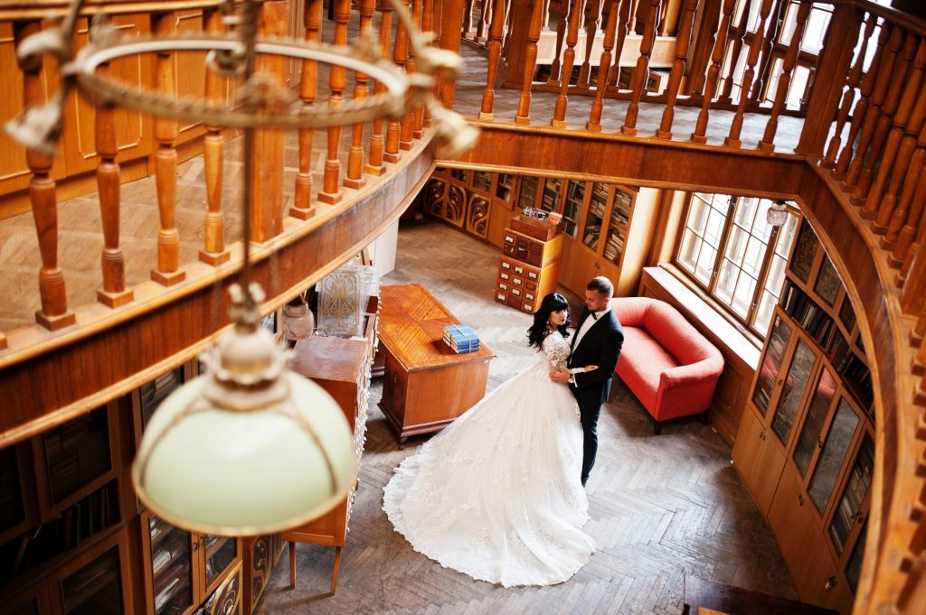 bride and groom in a library