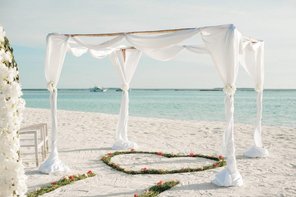 beach wedding with arch