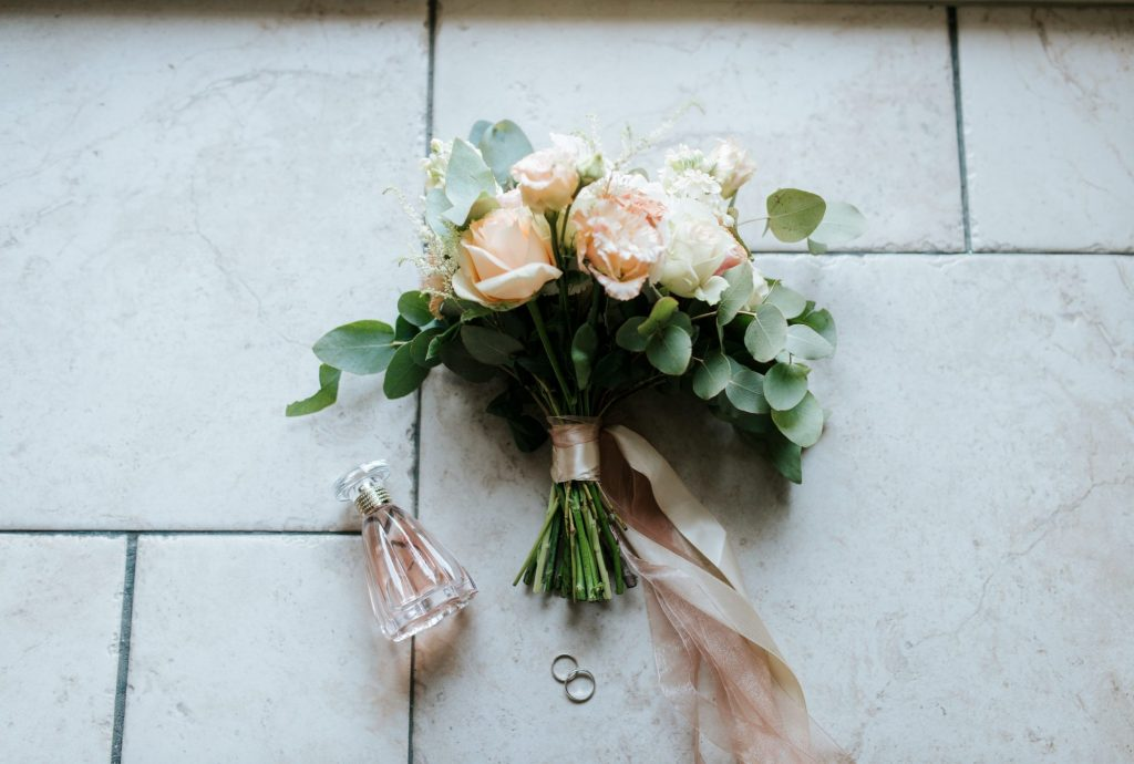 rings next to bouquet