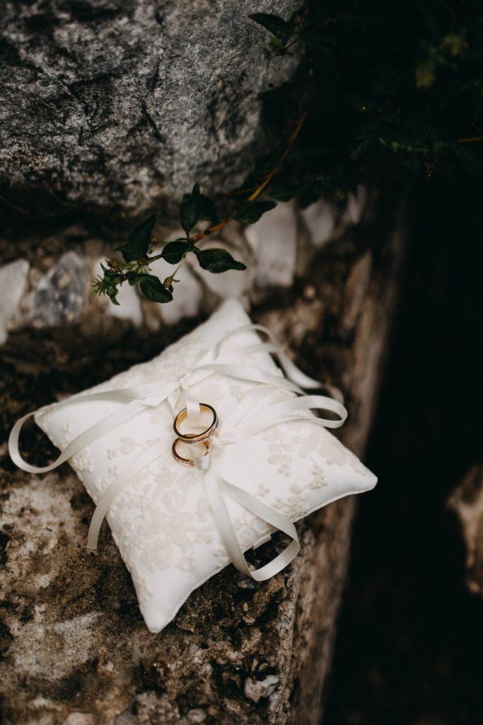 rings on pillow with dark background