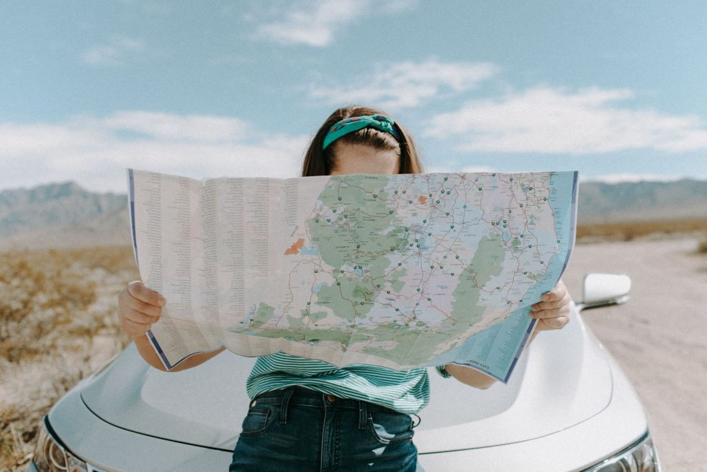 girl holding a map open