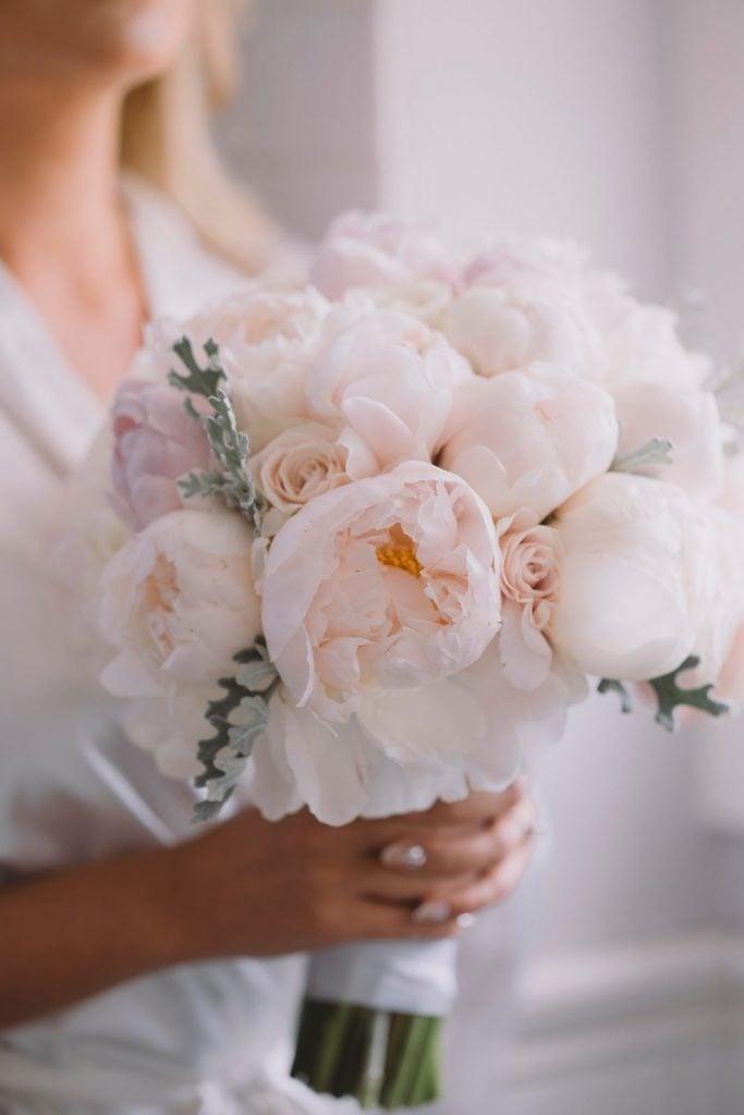 bride holding peonies