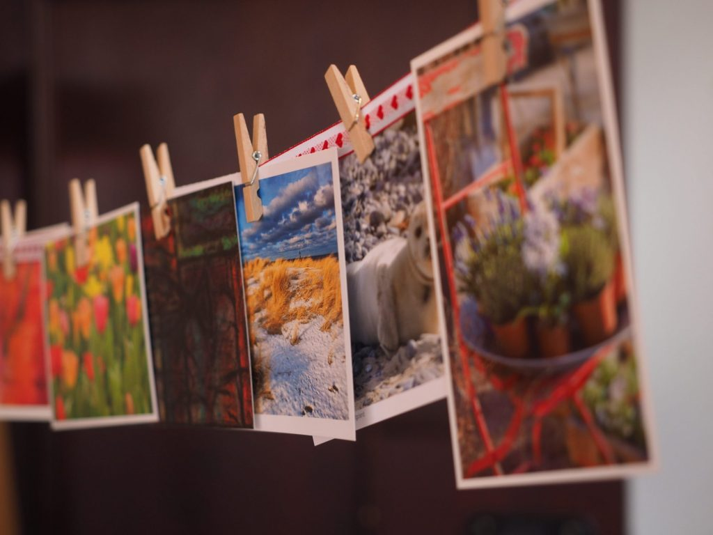 post cards hanging on line