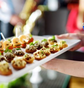 wedding caterer holding appetizers